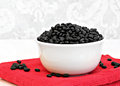 Black turtle beans in a white bowl. Royalty Free Stock Photo