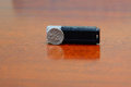 Black usb flash drive and a dime Royalty Free Stock Photo