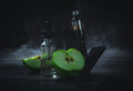 Black vaporizer in the smoke with sliced apple Royalty Free Stock Photo