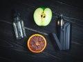 Black vaporizer in the smoke with sliced orange-apple Royalty Free Stock Photo