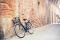 Black vintage bicycle on a street in Tuscany village, Italy Royalty Free Stock Photo
