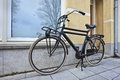 Black vintage bike parked in front of a house, Amsterdam, Netherlands Royalty Free Stock Photo