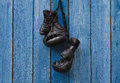 Black vintage boxing gloves hanging on an old rusty nail Royalty Free Stock Photo