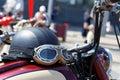 Black vintage moto helmet with glasses on motorcycle Royalty Free Stock Photo