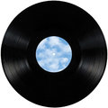 Black vinyl record lp album disc, isolated long play disk with blank empty label copy space in sky bule, clouds, summer cloudscape Royalty Free Stock Photo