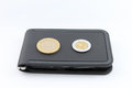 Black wallet with coins on white background Royalty Free Stock Photo