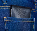 Black wallet inside of jeans back pocket Royalty Free Stock Photo
