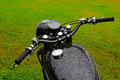 Black wet vintage motorbike Royalty Free Stock Photography