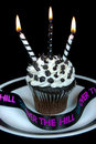 Black and white candles on cupcake birthday with with ribbon Royalty Free Stock Images