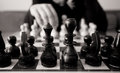 Black and white chess concept with man make move Royalty Free Stock Photos