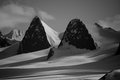 Black and white cliffs on snowy glacier Stock Photography