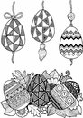 Black-and-white Easter eggs isolated on white. Abstract background made of flowers and Easter eggs.