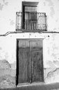 Black and white facade full frame take of a weathered mediterranean village house Stock Images