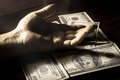 Black and white filtered human hand on money. Royalty Free Stock Photo