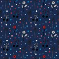 Black and white flowers and circles on a dark blue background seamless pattern