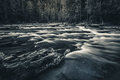Black and white flowing river. Royalty Free Stock Photo