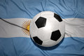 Black and white football ball on the national flag of argentina Royalty Free Stock Photo