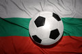 Black and white football ball on the national flag of bulgaria Royalty Free Stock Photo
