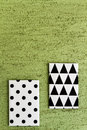 Black and white geometric canvases geometrical painted hanging on green wall Royalty Free Stock Image