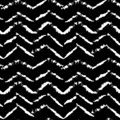Black and white hand drawn dry brush zig zag seamless pattern. Vector illustration.
