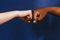 Black and white hand, fist bump gesture, contrast Royalty Free Stock Photo