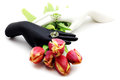 Black and white hands hold tulips a bouquet of Stock Photo
