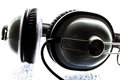 Black and white headphone on top of a frosted glass background Royalty Free Stock Image