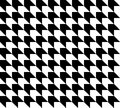 Black and white houndstooth pattern vector. Royalty Free Stock Photo