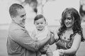 Black and white Image of happy family of three Royalty Free Stock Photo