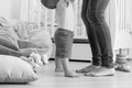 Black and white image of 10 months old baby learning how to walk Royalty Free Stock Photo