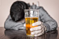 Black and white image of a sleeping drunk man only his beer is in color Royalty Free Stock Image