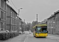 Black and white image and the yellow bus Royalty Free Stock Photo