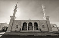 Black and white mosque with two minarets Royalty Free Stock Photo
