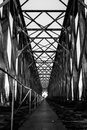 Black and white old industrial railway railroad iron bridge cent Royalty Free Stock Photo