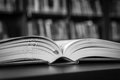 Black and white open book on the table in a library Royalty Free Stock Photo