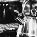 Black and White Steaming Tea Kettle Royalty Free Stock Photo