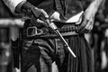 Black and white photograph of gunfighter and colt revolver outlaw loading his Stock Image