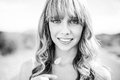 Black and white photograph of smiling natural blonde Royalty Free Stock Photo