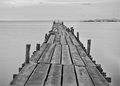 Black and white photography of a beach wooden pier thailand Royalty Free Stock Photos