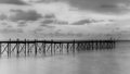 Black and white photography of a beach wooden pier thailand Stock Images