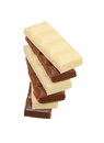 Black and white porous chocolate on white background pieces of stacked isolated Stock Photos