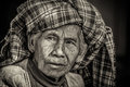 Black and white portrait of an old indigenous woman in Myanmar Royalty Free Stock Photo