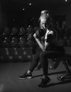 Black and white portrait of sports woman with dumbbell in gym Stock Photos