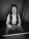 Black and white portrait of teenage girl in eyeglasses sitting a Royalty Free Stock Photo
