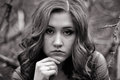 Black and white portrait of young girl very very upset with wavy hair person she has lots problems she doesn t know what to Royalty Free Stock Photo