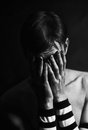 Black and white portrait of  young man crying covering the face Royalty Free Stock Photo
