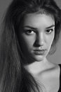 Black white portrait of young woman model shooting beautiful fashion long straight hair natural makeup clear glowing skin Stock Image