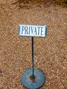 Black and white private sign post metal cobble floor Royalty Free Stock Photo