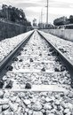 Black and white railway leading to industry Royalty Free Stock Photo