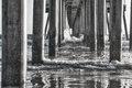 Black and White Reflections under Ocean Pier Royalty Free Stock Photo